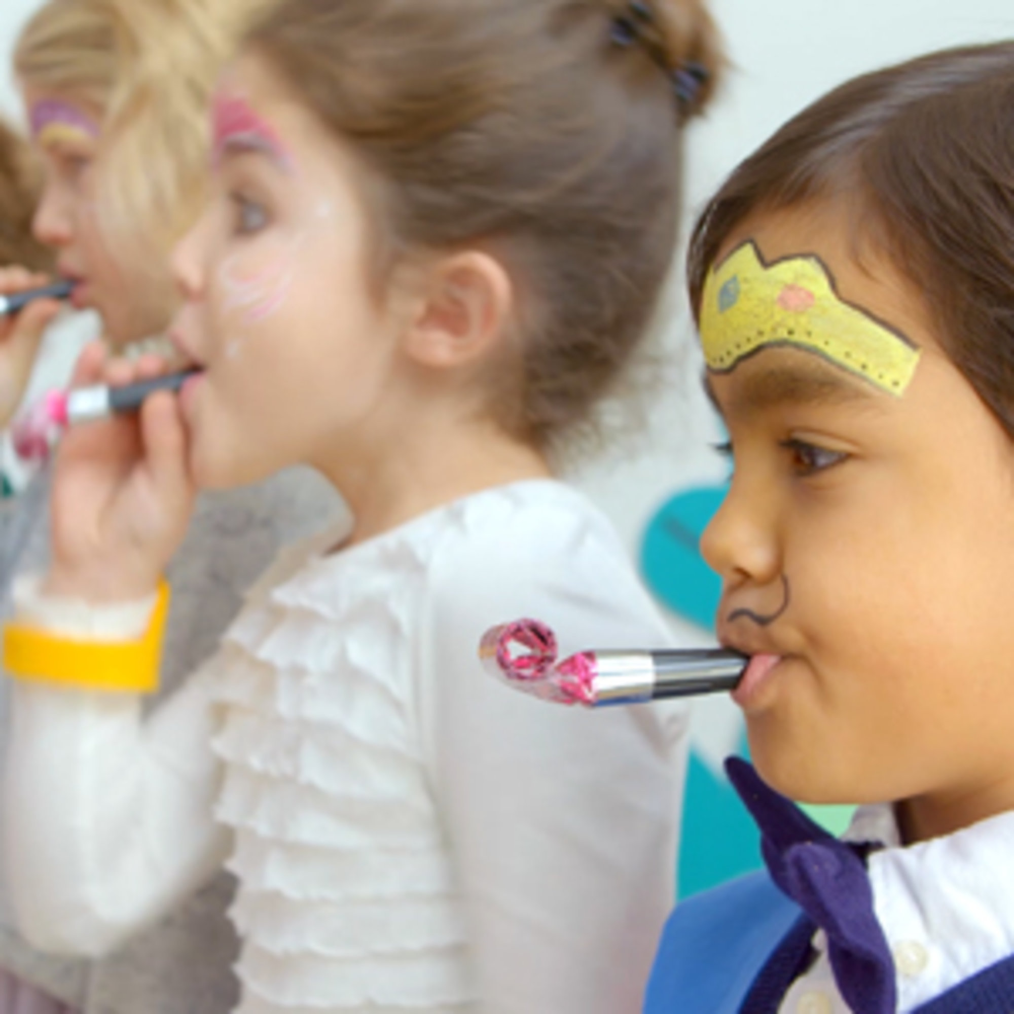 Kids with a party blowers