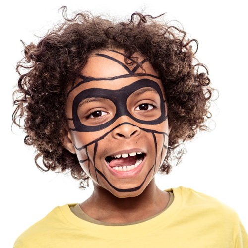 Boy with step 2 of Mummy Halloween face paint design