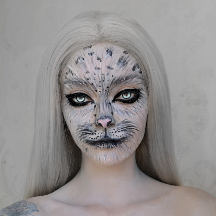 girl with Snow Leopard paint design
