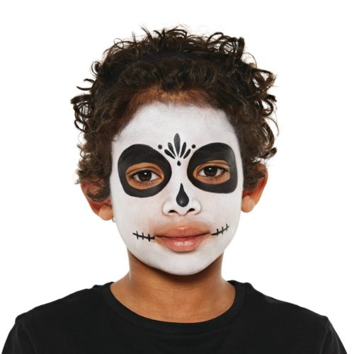 Boy with step 1 of Sugar Skull face paint design