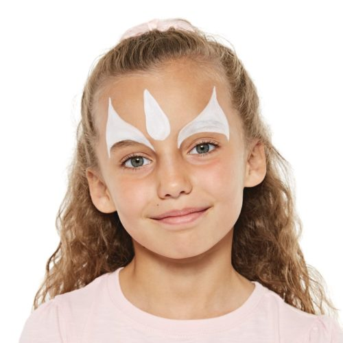 girl with step 1 of unicorn face paint design