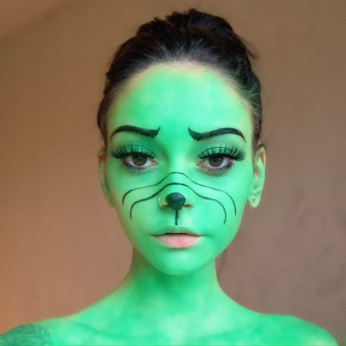 girl with step 2 of Grinch Christmas face paint design