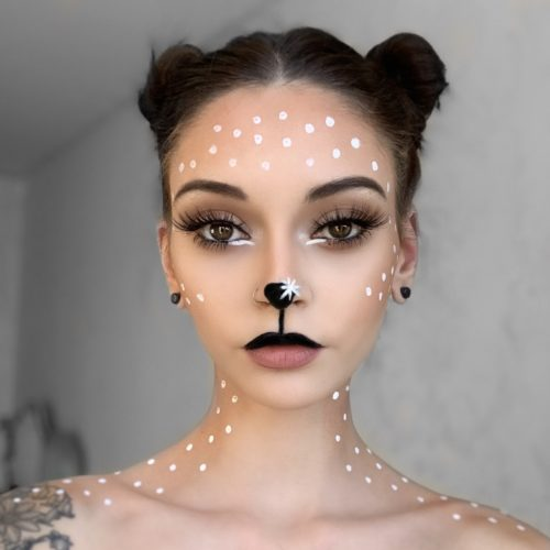girl with step 3 of Reindeer face paint design. Christmas costume and face paint ideas