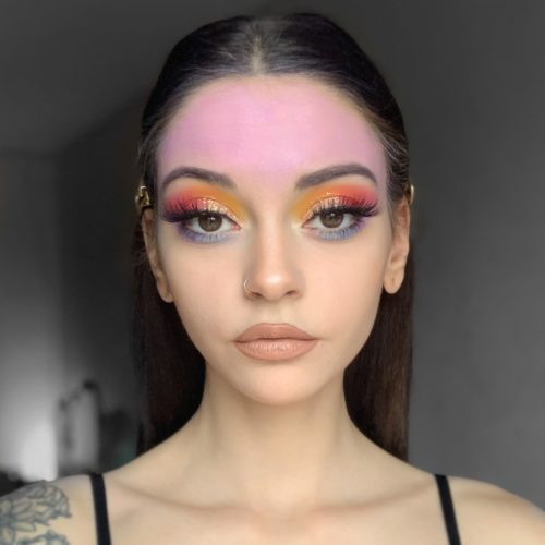 girl with step 1 of Firework face paint design