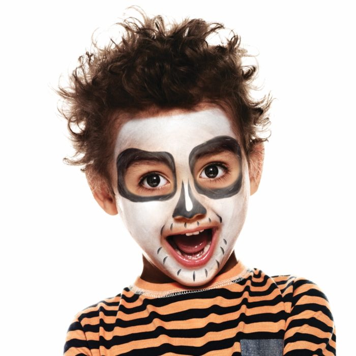 Boy with Cheeky Skeleton Halloween face paint design
