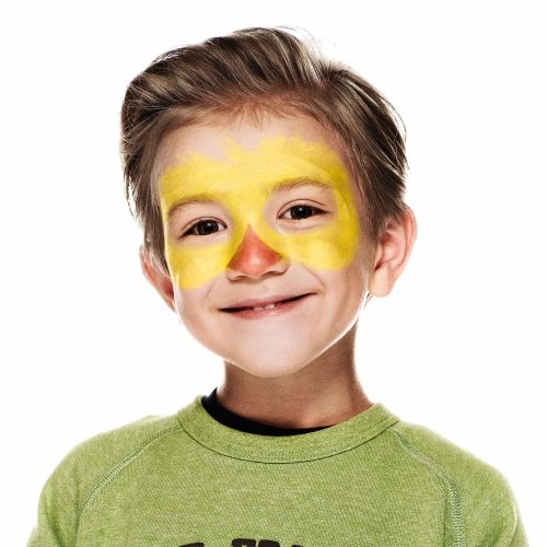 boy with step 1 of Chick face paint design