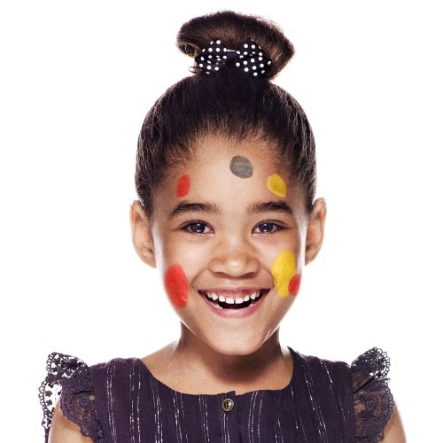 girl with step 1 of Easter Egg face paint design