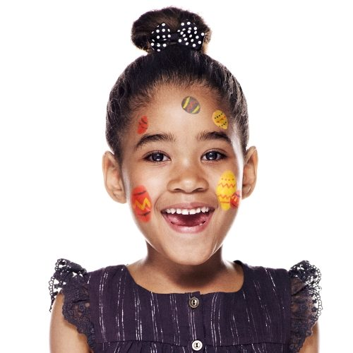 girl with step 2 of Easter Egg face paint design