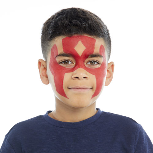 Boy with step 1 of Super Warrior face paint design