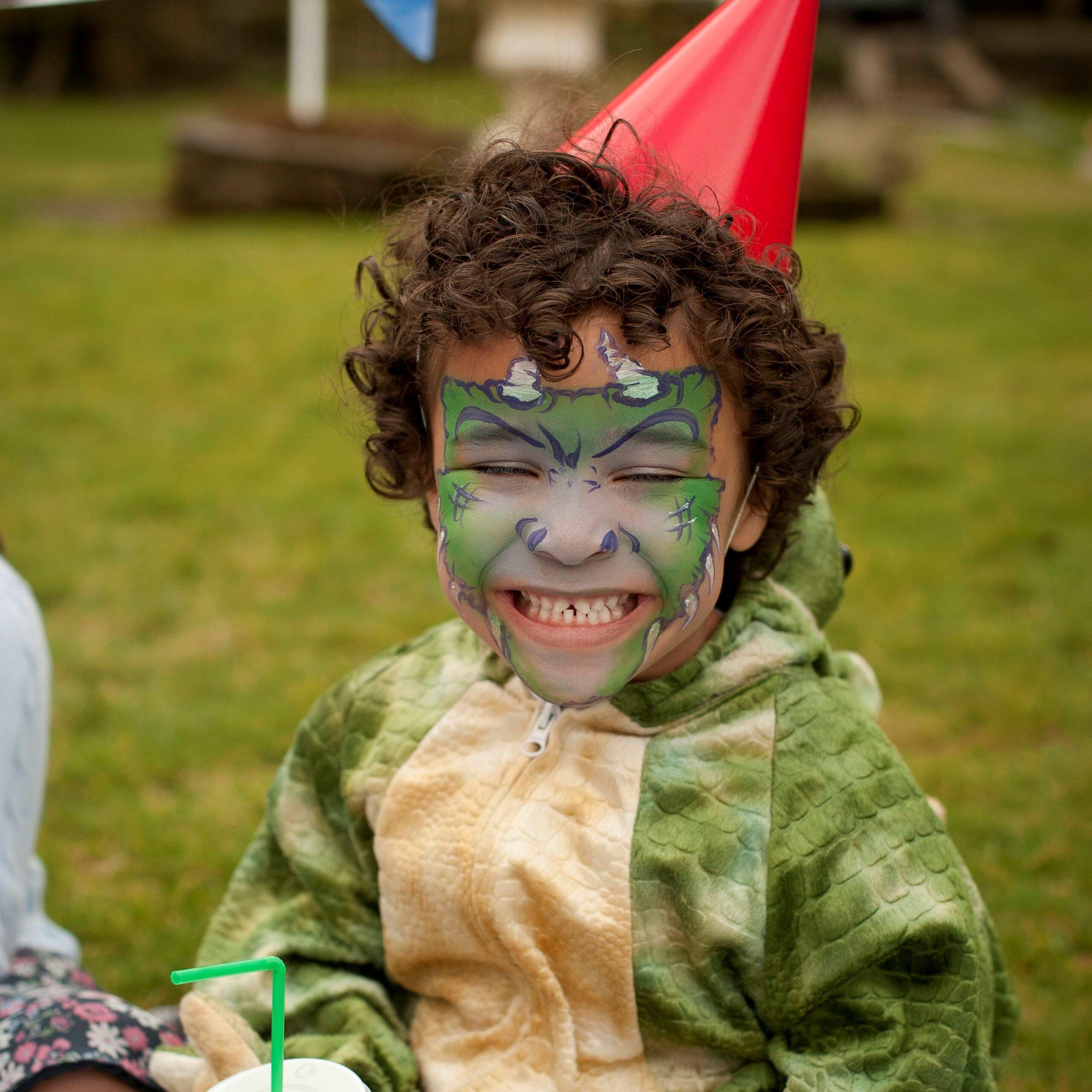 Boy with Snazaroo Dinosaur Face Paint at Birthday Party