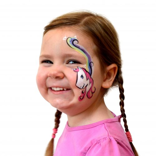Girl with kids unicorn face paint. Step 3 of a 3 step guide.