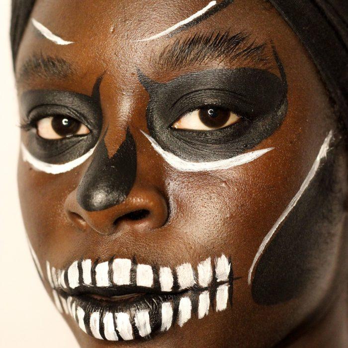 Spooky Skull face paint makeup design for Halloween