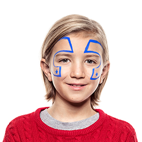 Boy with step 1 of Superhero face paint design