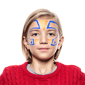 Boy with step 2 of Superhero face paint design