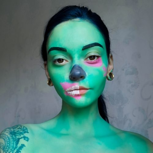 girl with step 2 of Gaming Zombie face paint design