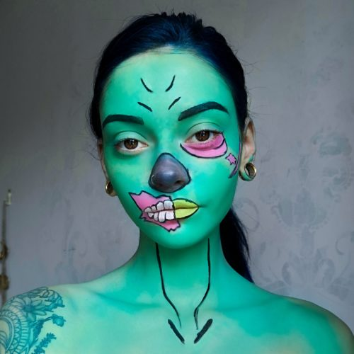 girl with step 3 of Gaming Zombie face paint design