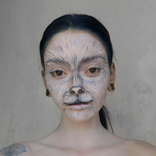 girl with step 2 of Snow Leopard paint design