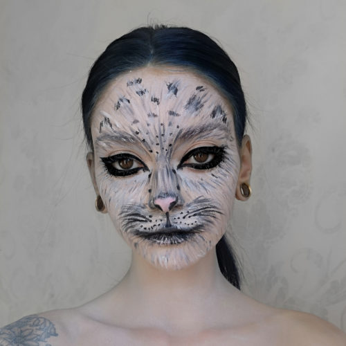 girl with step 3 of Snow Leopard paint design