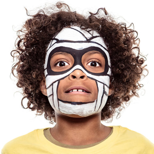 Boy with step 2 of Mummy face paint design for Halloween