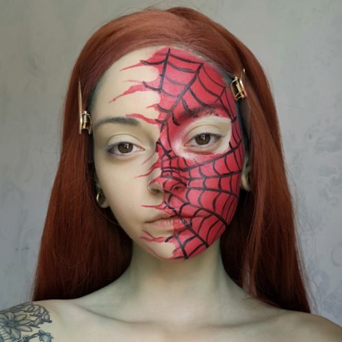 girl with step 2 of Spider face paint design