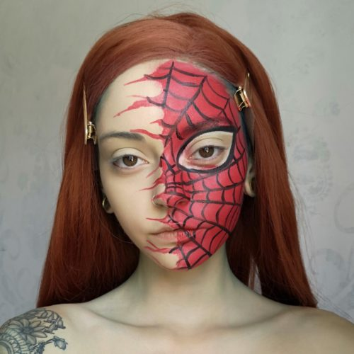 girl with step 3 of Spider face paint design