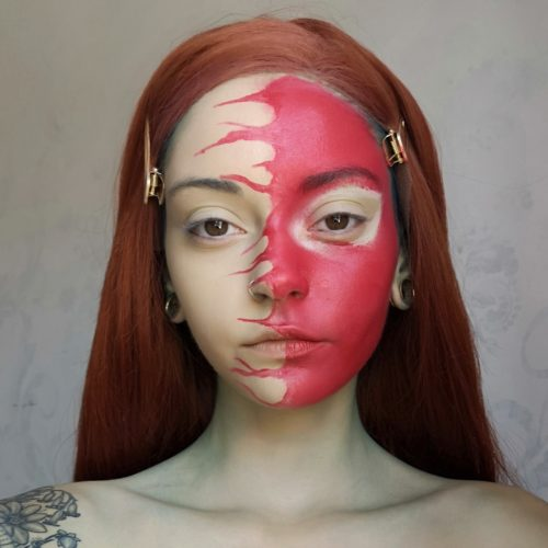 girl with step 1 of Spider face paint design