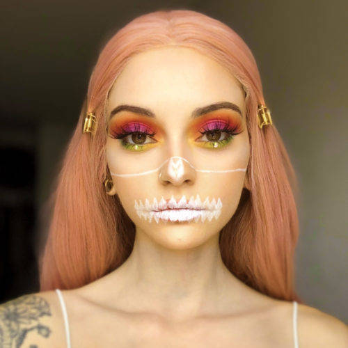 girl with step 1 of Glam Skull face paint design