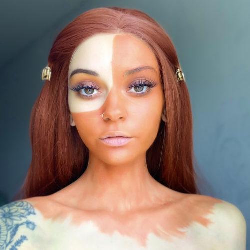 girl with step 1 of Pumpkin Halloween face paint tutorial design