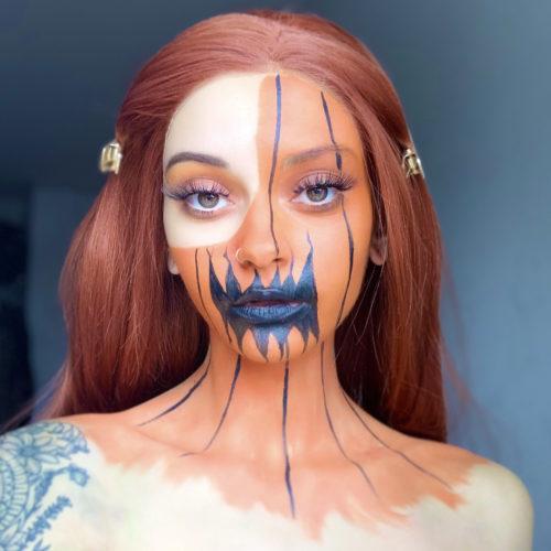 girl with step 2 of Pumpkin Halloween face paint tutorial design