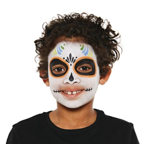 Boy with step 2 of Sugar Skull face paint design