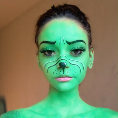 girl with Miss Grinch face paint design for Christmas
