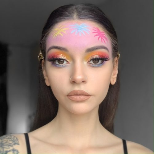 girl with step 2 of Fab Firework face paint design