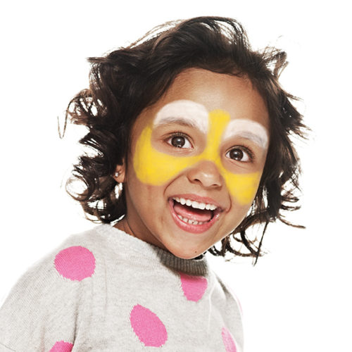 girl with step 1 of Bee face paint design