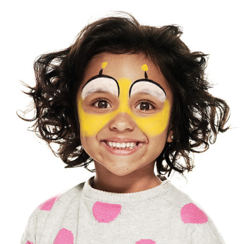 girl with step 2 of Bee face paint design