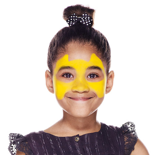 girl with step 1 of Cheetah face paint design