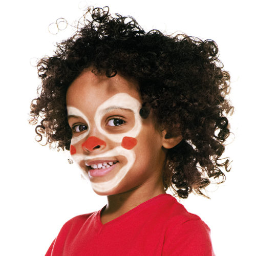 Boy with step 2 of Clown face paint design