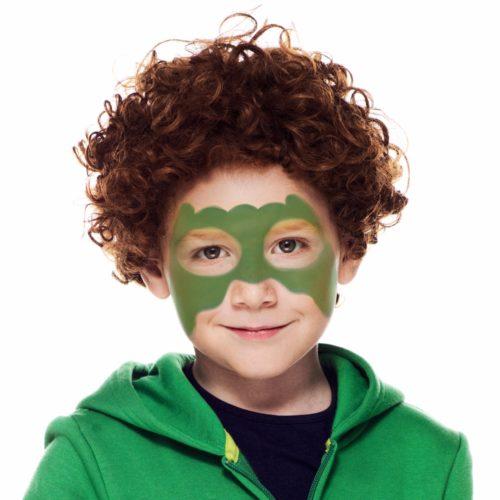 Boy with step 1 of Dinosaur Boy face paint design