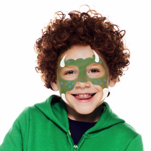 Boy with step 2 of Dinosaur Boy face paint design