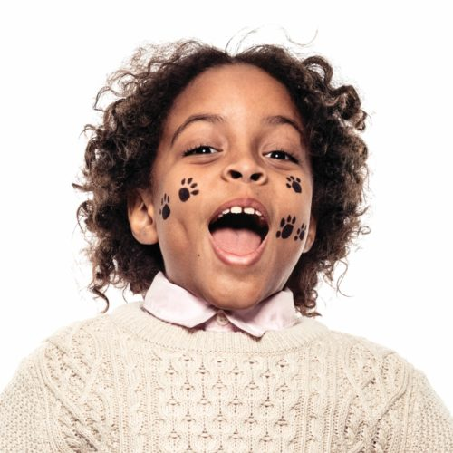 Boy with step 2 of Paws face paint design