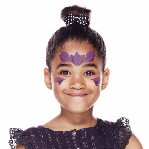 girl with step 1 of Princess Purple face paint design