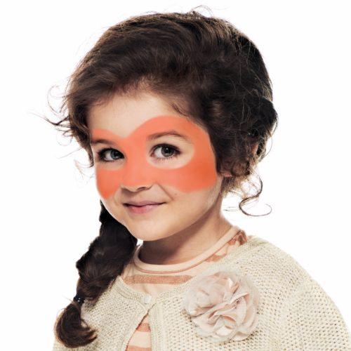 girl with step 1 of Halloween Pumpkin face paint design