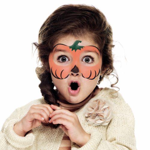girl with Halloween Pumpkin face paint design