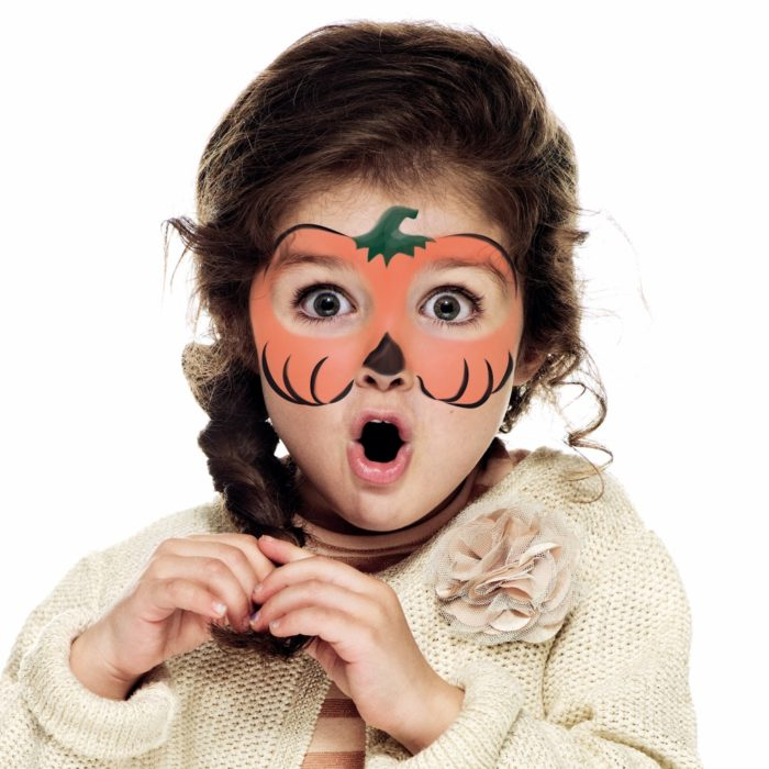 girl with Halloween Pumpkin face paint design