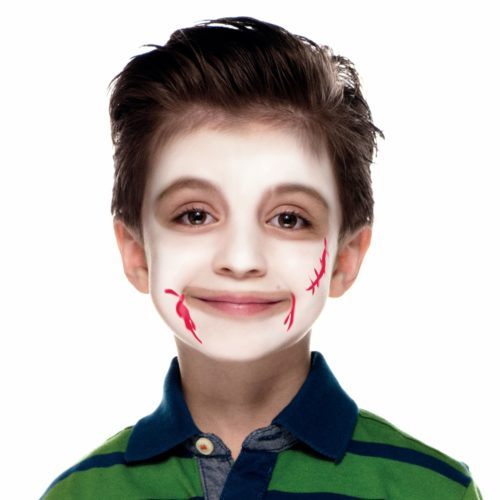 Boy with step 2 of Vampire face paint design