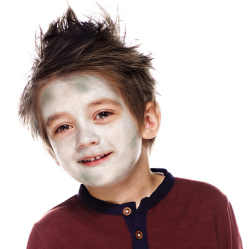 Boy with step 1 of Zombie face paint design