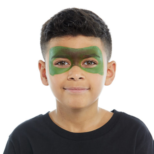Boy with step 1 of Dinosaur face paint design