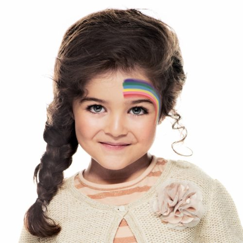girl with step 1 of Rainbow face paint design