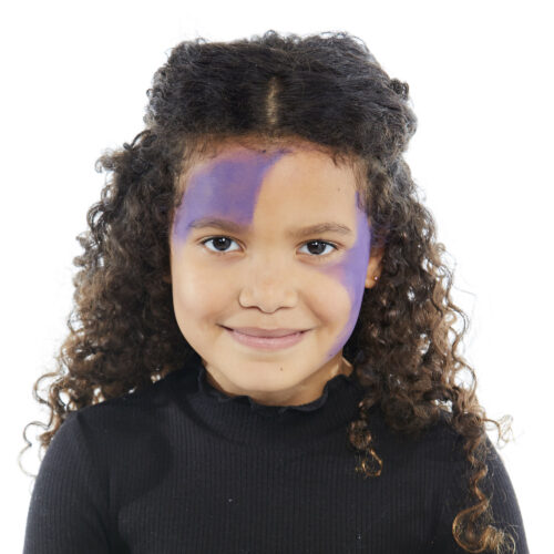 Girl with step 1 of Spider Girl face paint design for Halloween