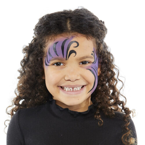 Girl with step 2 of Spider Girl face paint design for Halloween