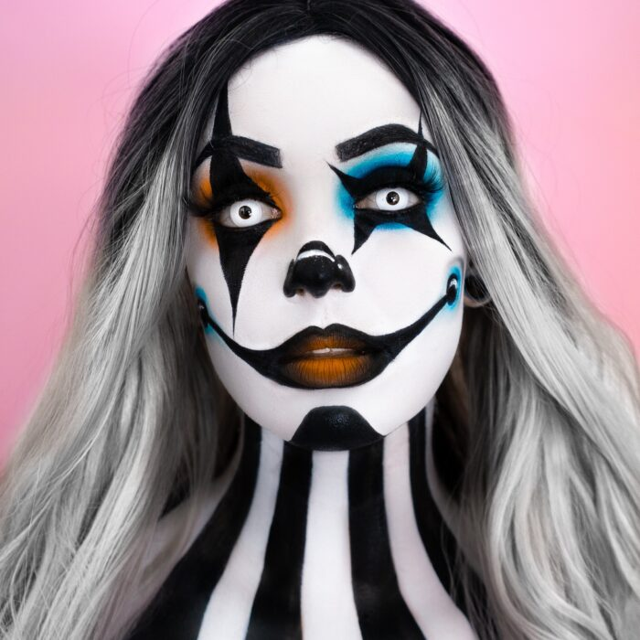 girl with Clown face paint design for Halloween